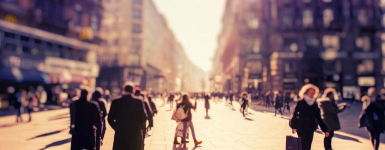 Blurry image of people in street.