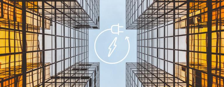 Looking up in-between 2 glass buildings with a power generation icon in the centre
