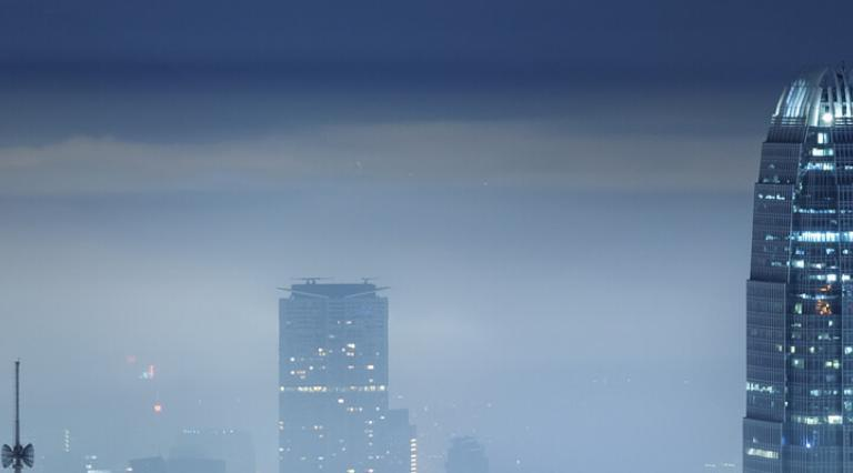 Foggy city skyline at night.