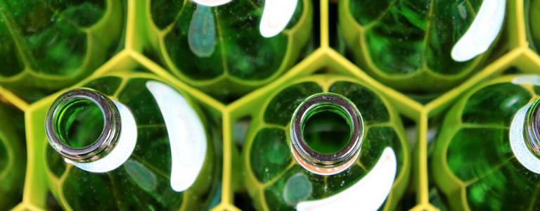 Close up of green bottles.